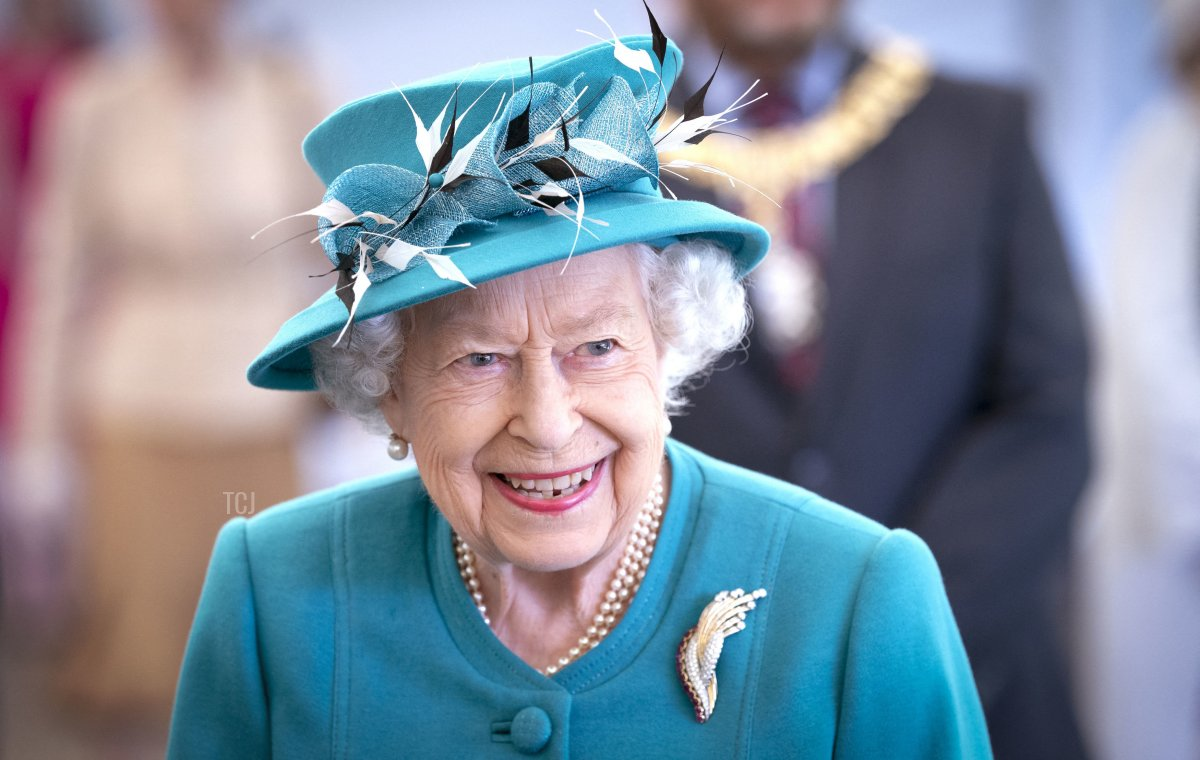 Britain's Queen Elizabeth II gestures during a visit to the Edinburgh Climate Change Institute at the University of Edinburgh in Edinburgh, Scotland on July 1, 2021, as part of her traditional trip to Scotland for Holyrood Week
