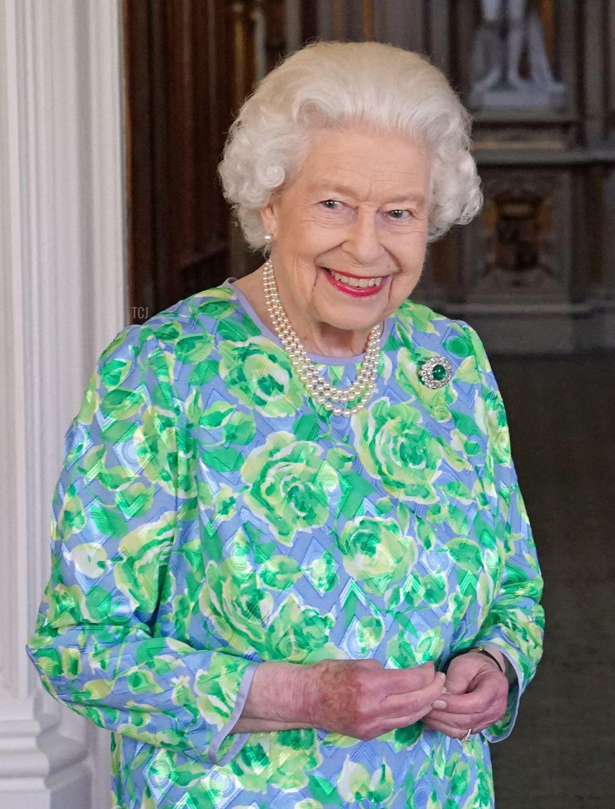 Britain's Queen Elizabeth II receives German Chancellor Angela Merkel during an audience at Windsor Castle in Windsor, Berkshire on July 2, 2021