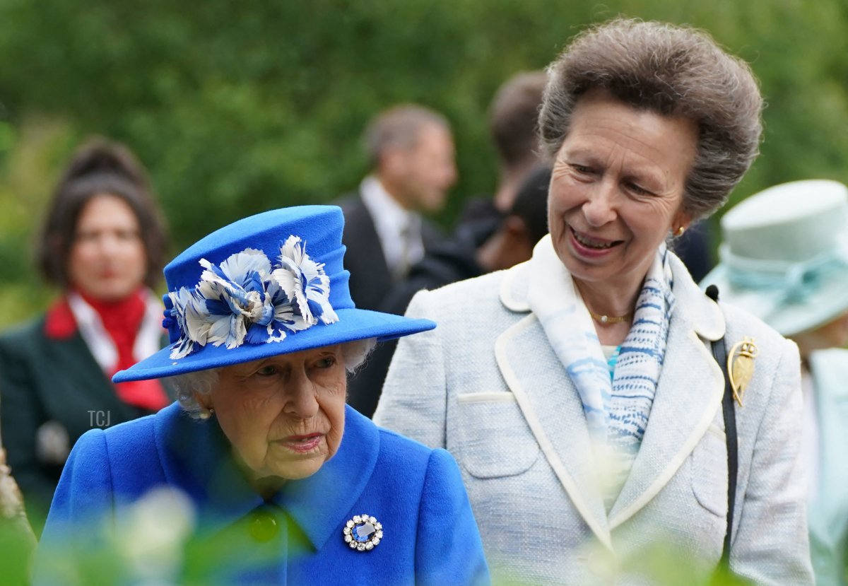 Britain's Princess Anne, Princess Royal speaks to Britain's Queen Elizabeth II during a visit to The Childrens Wood Project in Glasgow on June 30, 2021, as part of her traditional trip to Scotland for Holyrood Week