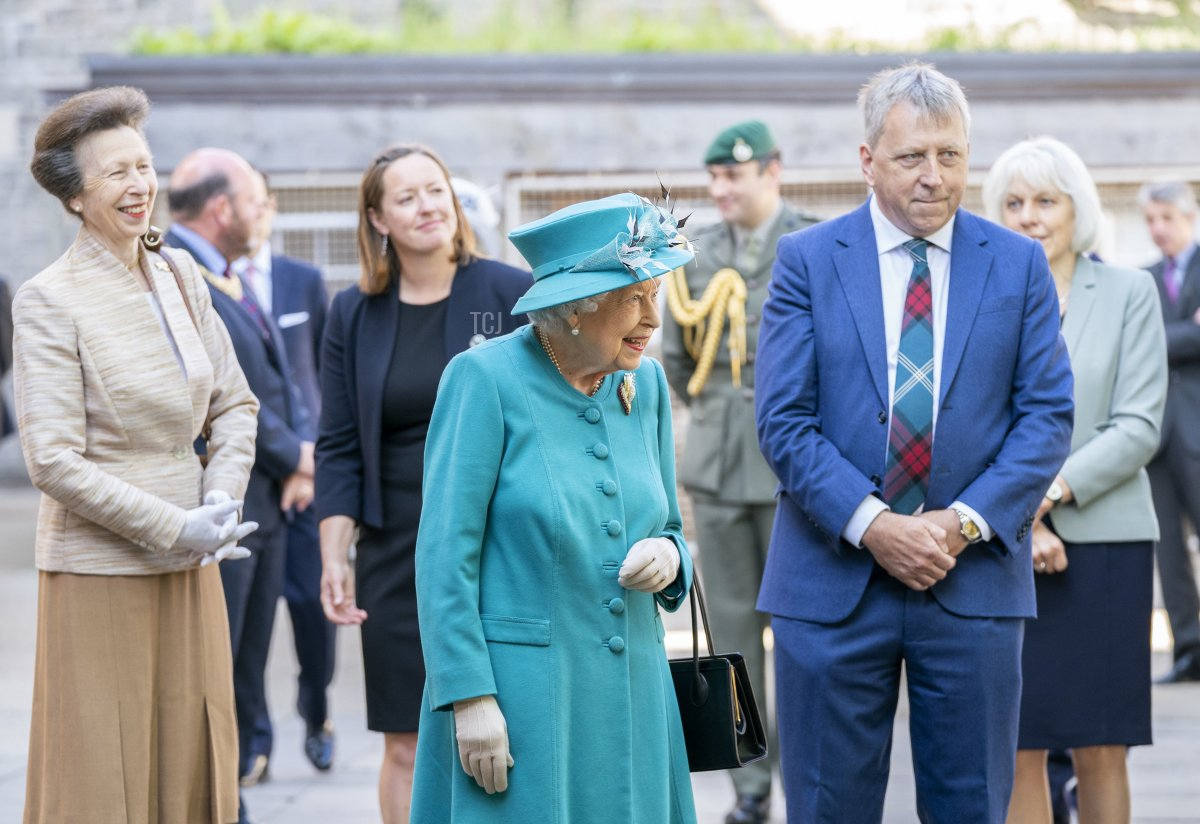 Queen Elizabeth II and The Princess Royal with Principal and Vice-Chancellor Peter Mathieson (R), during a visit to the Edinburgh Climate Change Institute, as part of her traditional trip to Scotland for Holyrood Week on July 1, 2021 in Edinburgh, Scotland