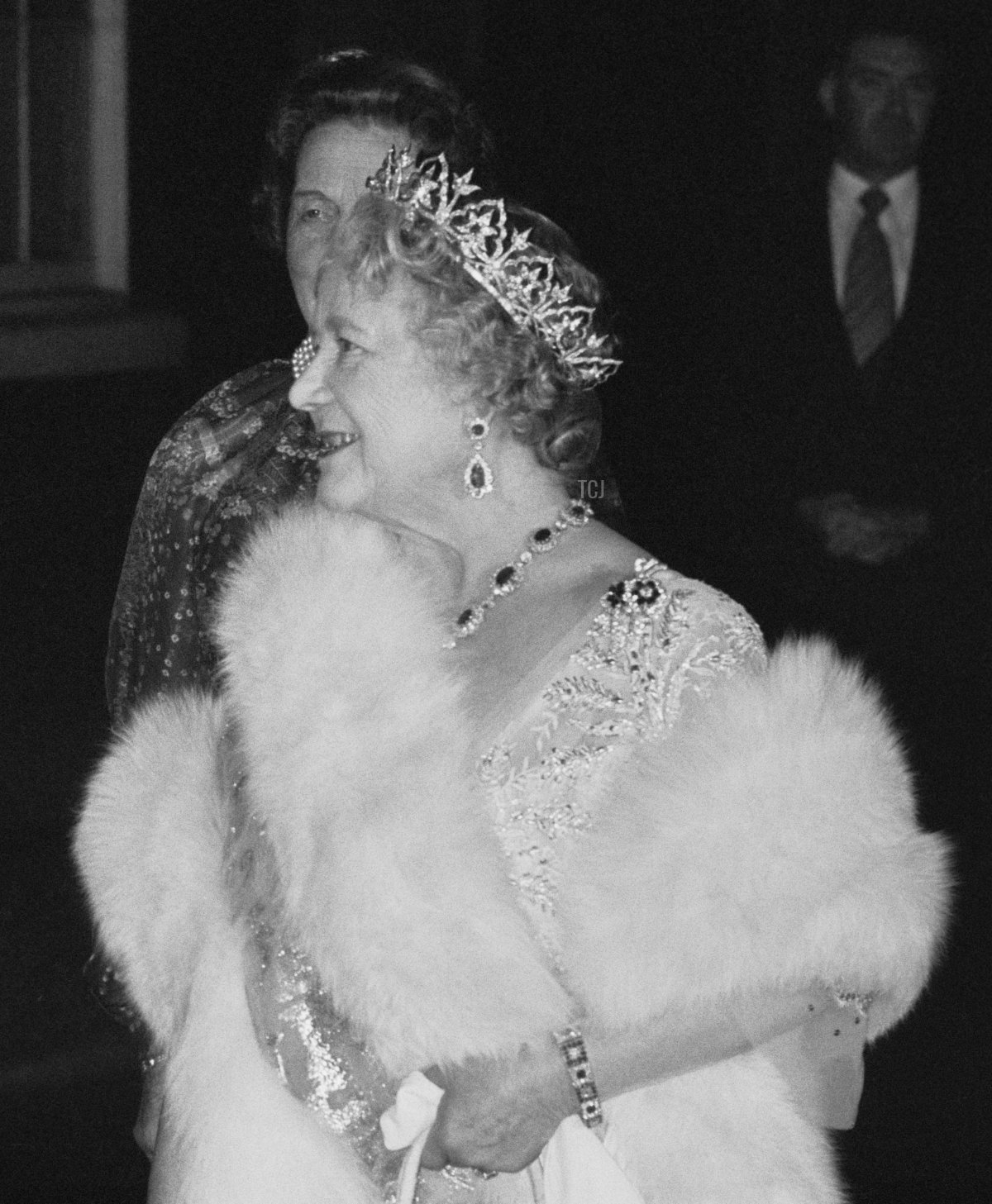 The Queen Mother (1900 - 2002) is greeted by the Prime Minister, Margaret Thatcher (1925 - 2013), upon her arrival at 10 Downing Street, where the Prime Minister hosted an 80th birthday party for the Queen Mother, London, UK, 12th November 1980