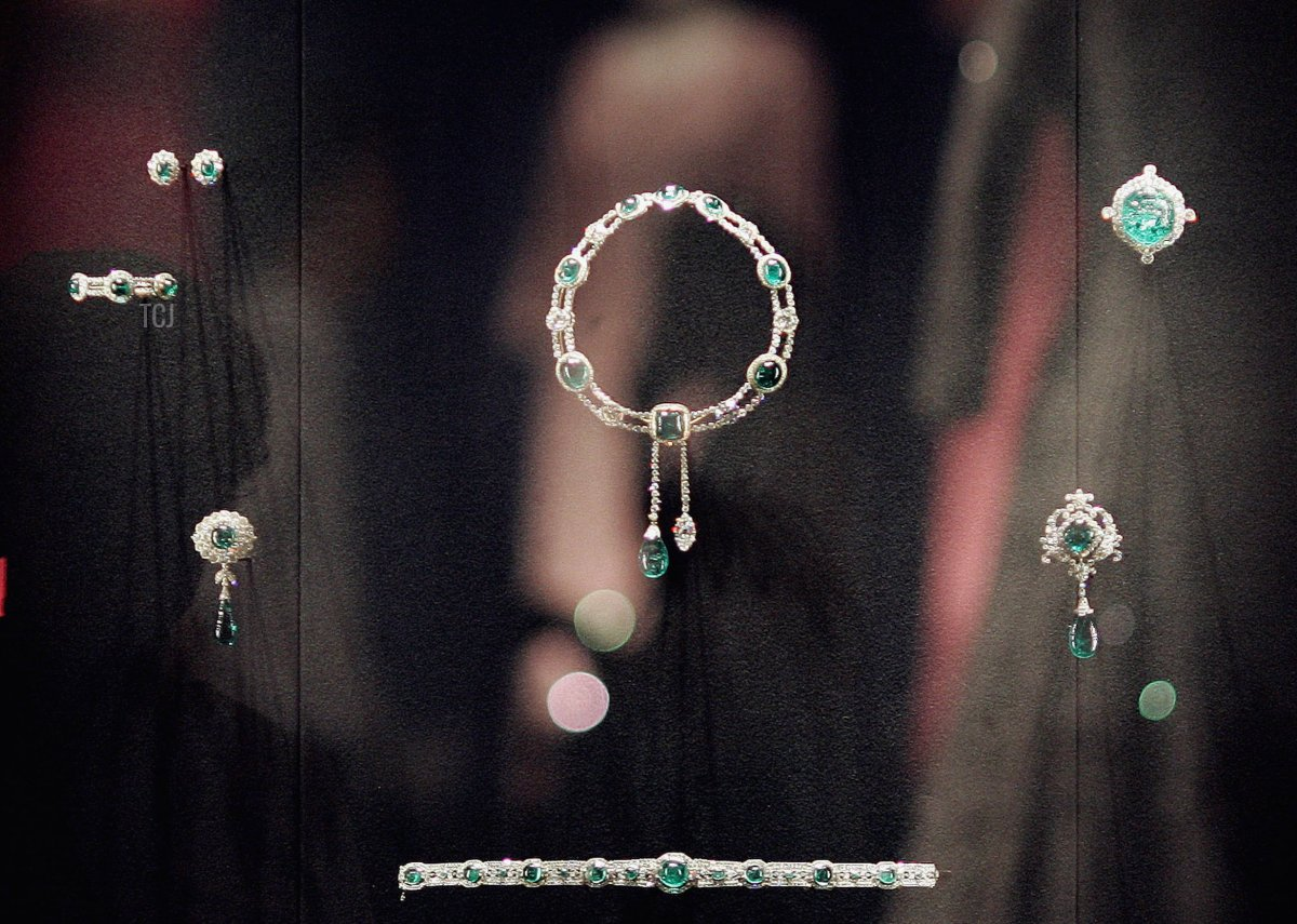 Queen Elizabeth II's dresses are reflected in a glass case displaying The Vladimir Tiara and The Delhi Durbar necklace at Buckingham Palace on July 25, 2006 in London
