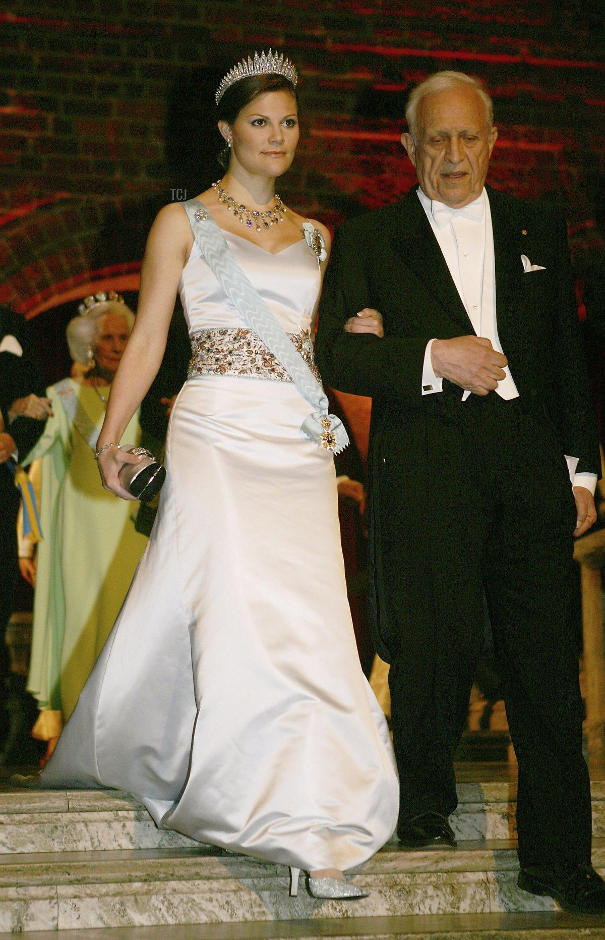 STOCKHOLM, SWEDEN - DECEMBER 10: Crown Princess Victoria of Sweden and Physics Nobel Prize Roy J. Glauber arrive at the Nobel Banquet held at the City Hall on December 10, 2005 in Stockholm, Sweden