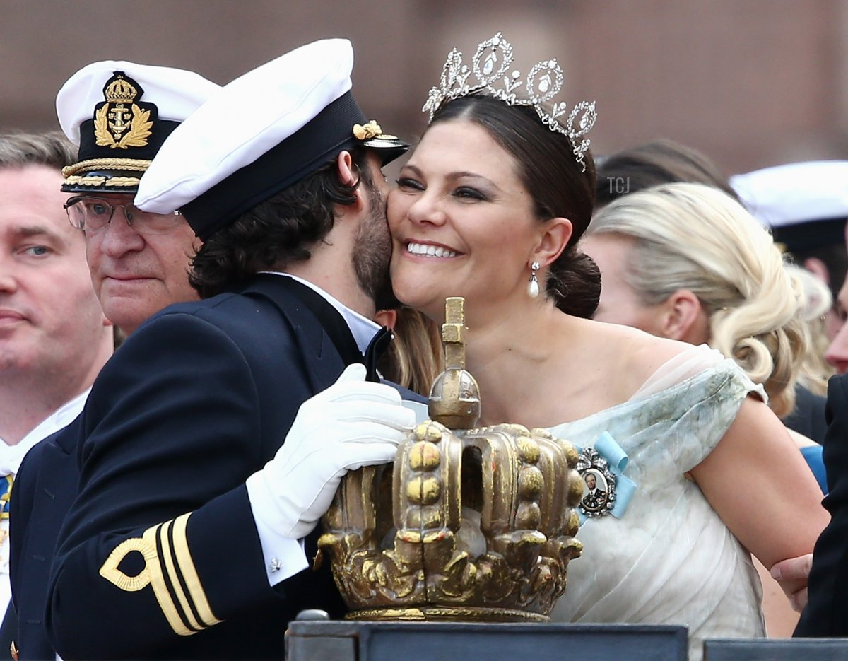 Prince Carl Philip of Sweden places one hand on the crown as he chats with his sister, Crown Princess Victoria of Sweden, after his marriage ceremony to Princess Sofia, at The Royal Palace on June 13, 2015 in Stockholm, Sweden