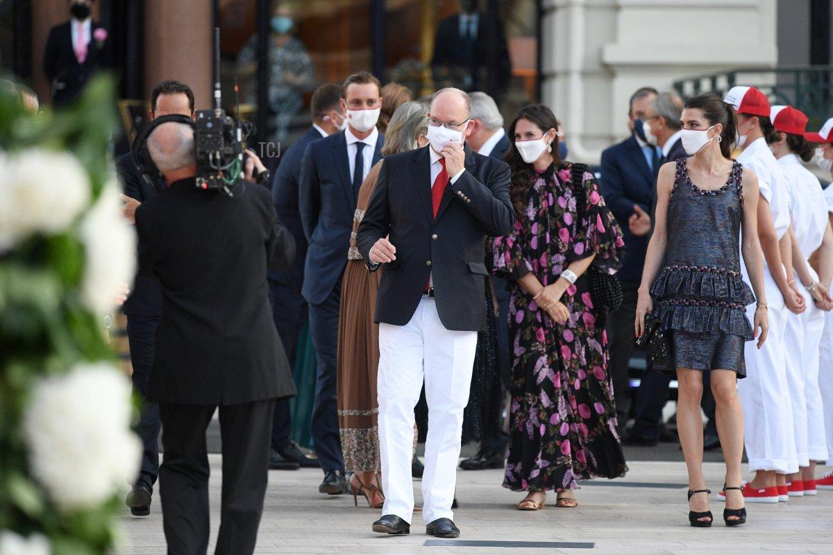 Prince Albert II of Monaco, Tatiana Santo Domingo and Charlotte Rassam arrive to attend the Red Cross Summer Concert on July 16, 2021 in Monte-Carlo, Monaco
