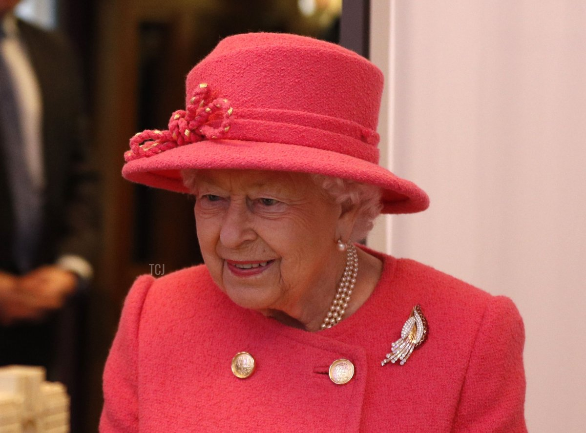 Britain's Queen Elizabeth II (R) views a model of the building as she visits the Royal Insitute of Chartered Surveyors (RICS) to mark its 150th anniversary in central London on November 20, 2018