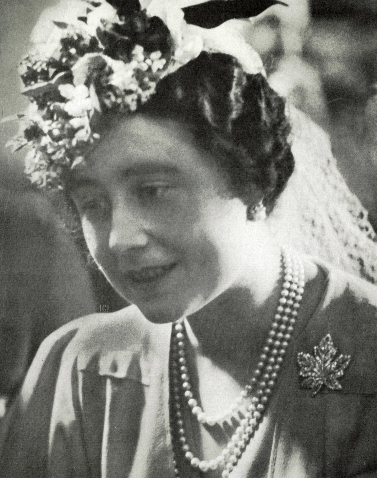 Queen Elizabeth wears the maple leaf brooch given to her by her husband King George VI, to mark their visit to Canada on June, 4, 1939 in Winnipeg