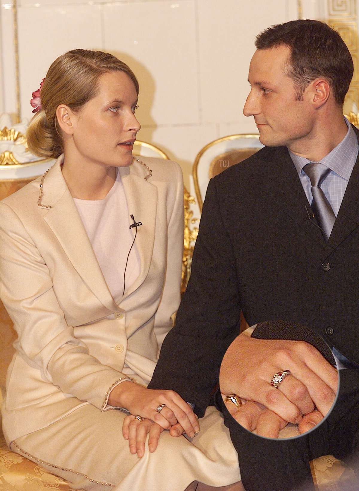 Mette-Marit Tjessem and HRH Crown Prince Haakon Magnus hold hands January 21, 2000 after announcing their engagement in Oslo, Norway