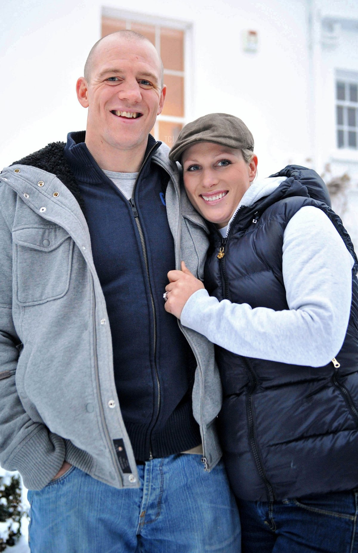 Zara Phillips, daughter of Princess Anne, and grand-daughter of Britain's Queen Elizabeth II, poses for a photograph with her fiance, England rugby player Mike Tindall, after the announcement of their engagement, at their home in Gloucestershire, south west England on December 21, 2010