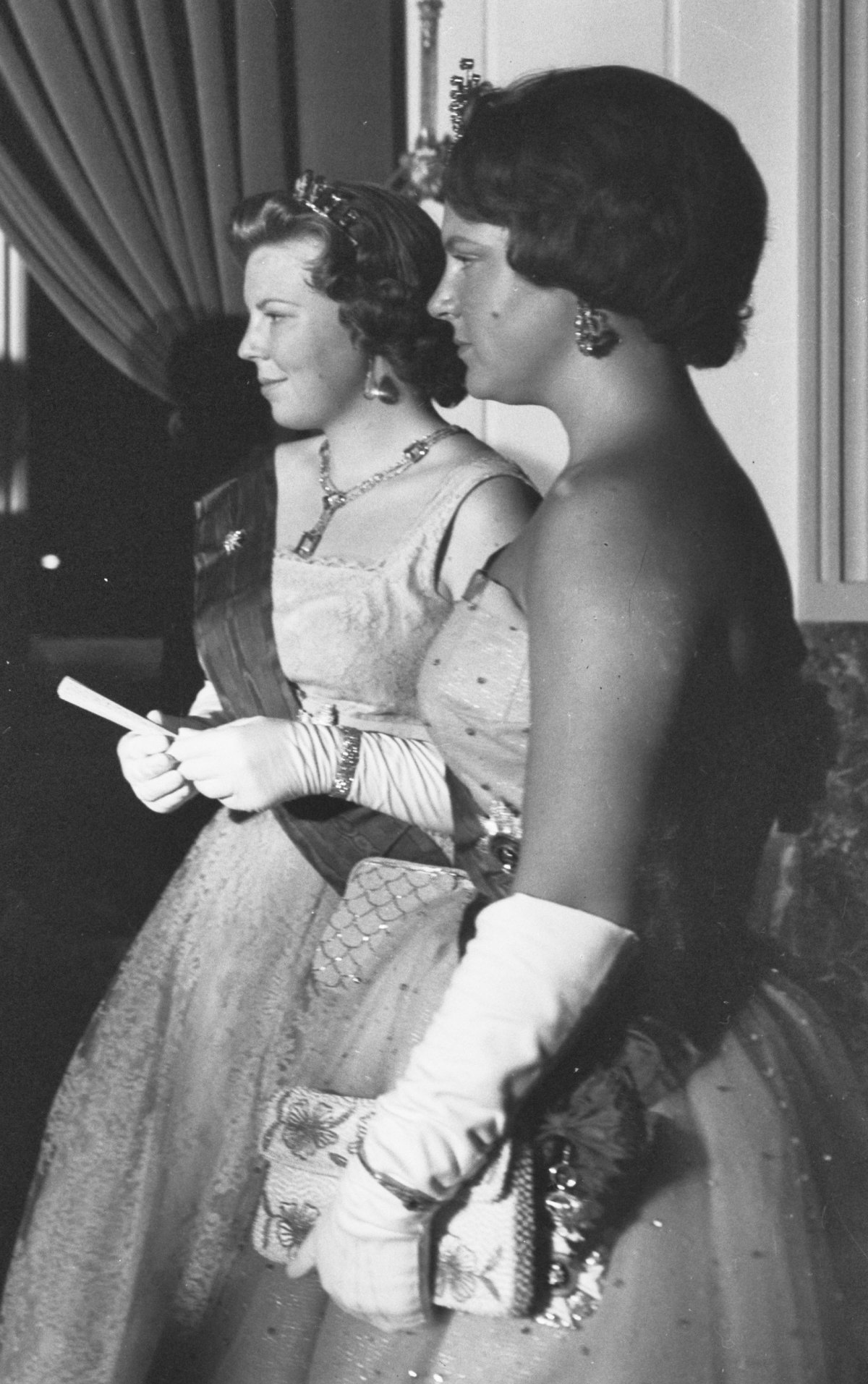 Princess Beatrix and Princess Irene of the Netherlands attend a gala during the Belgian state visit, July 1959