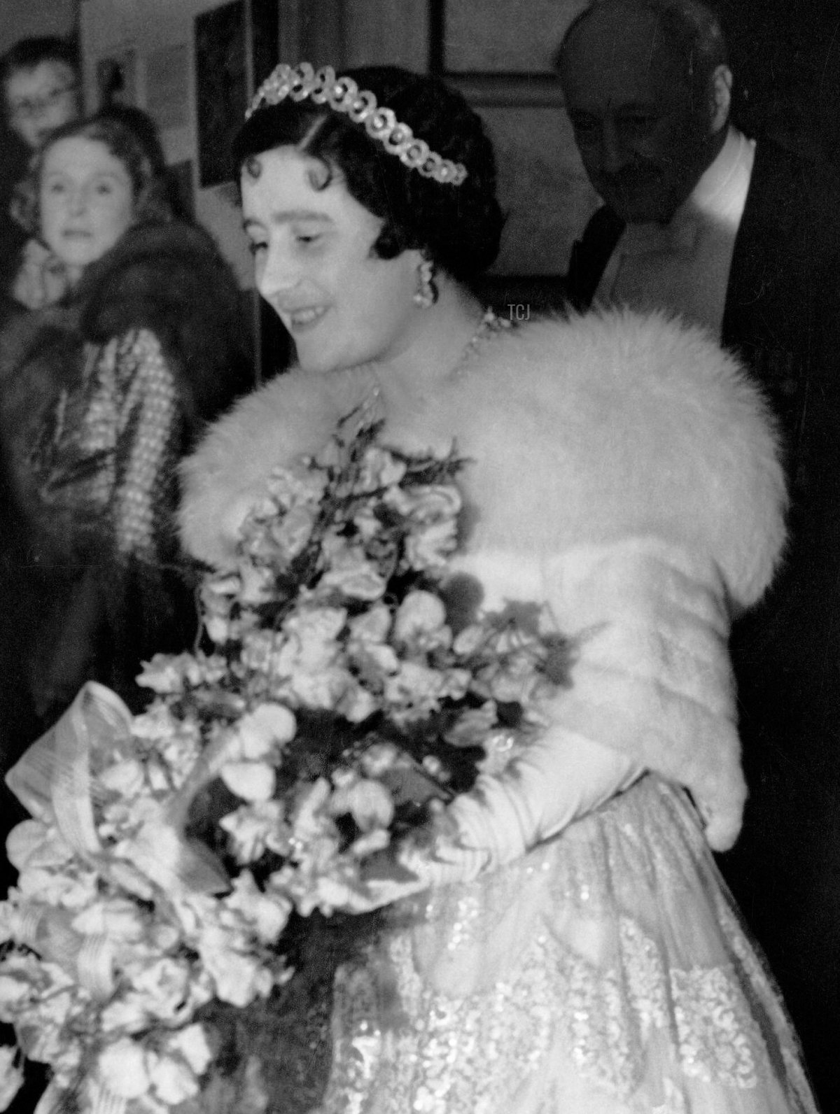 Queen Elizabeth of the United Kingdom (later the Queen Mother) wears the Teck Hoop Necklace Tiara for a performance by the Sadler's Wells Ballet School, May 1938