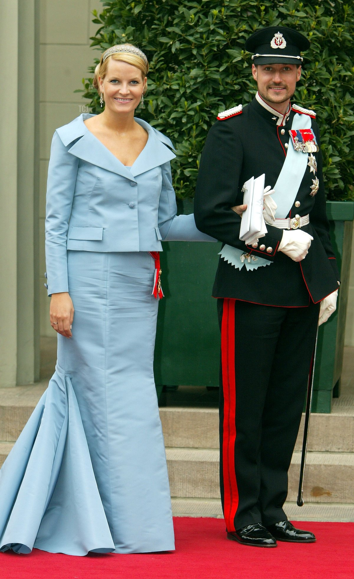 Norwegian Crown Prince Haakon and his wife Crown Princess Mette-Marit arrive to attend the wedding between Danish Crown Prince Frederik and Mary Donaldson in Copenhagen Cathedral May 14, 2004