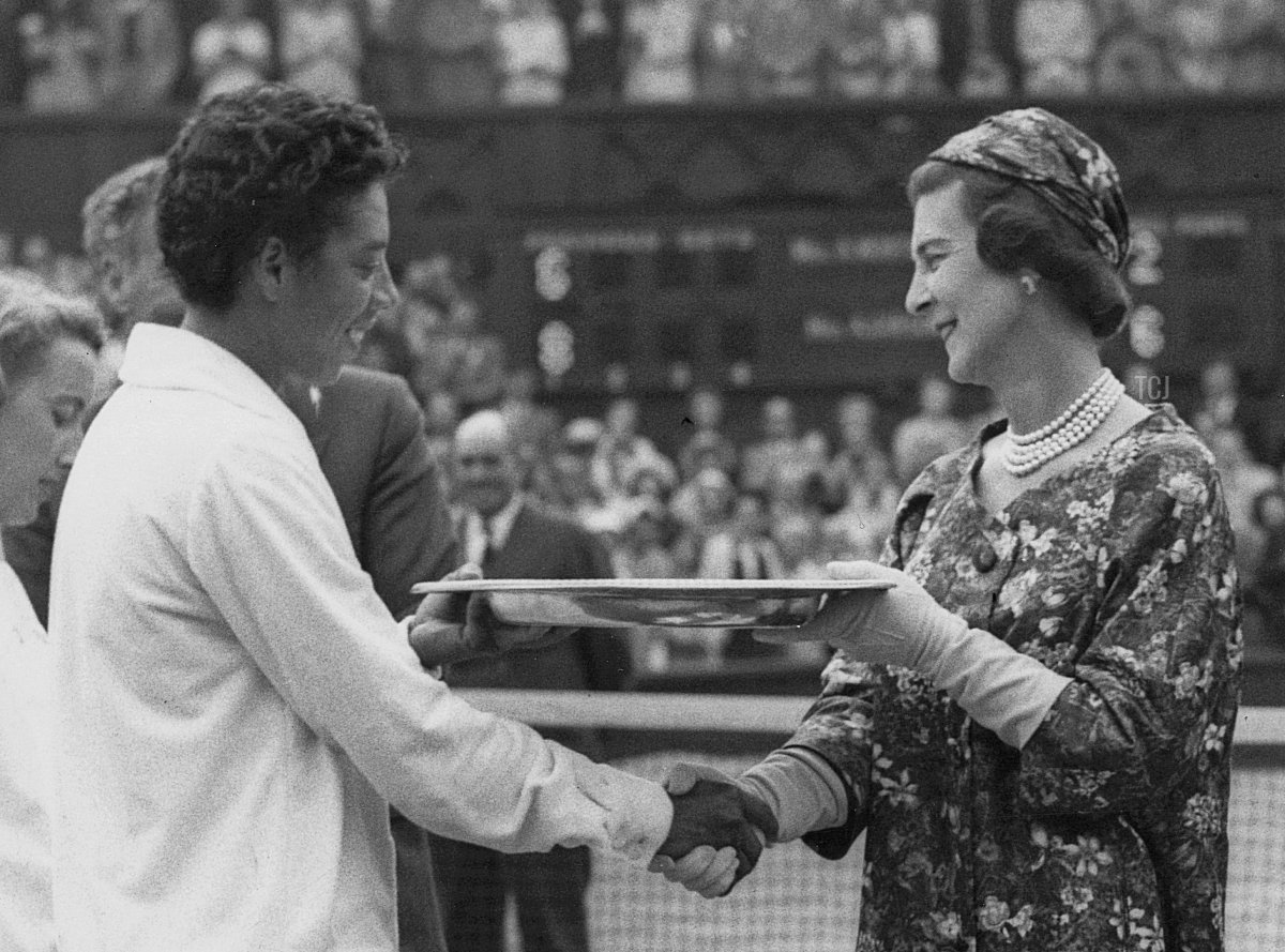 Althea Gibson (1927 - 2003) of the United States is presented with the Venus Rosewater Plate by Princess Marina the Duchess of Kent following her victory in the Women's Singles Final match on Centre Court at the Wimbledon Lawn Tennis Championship on 5th July 1958