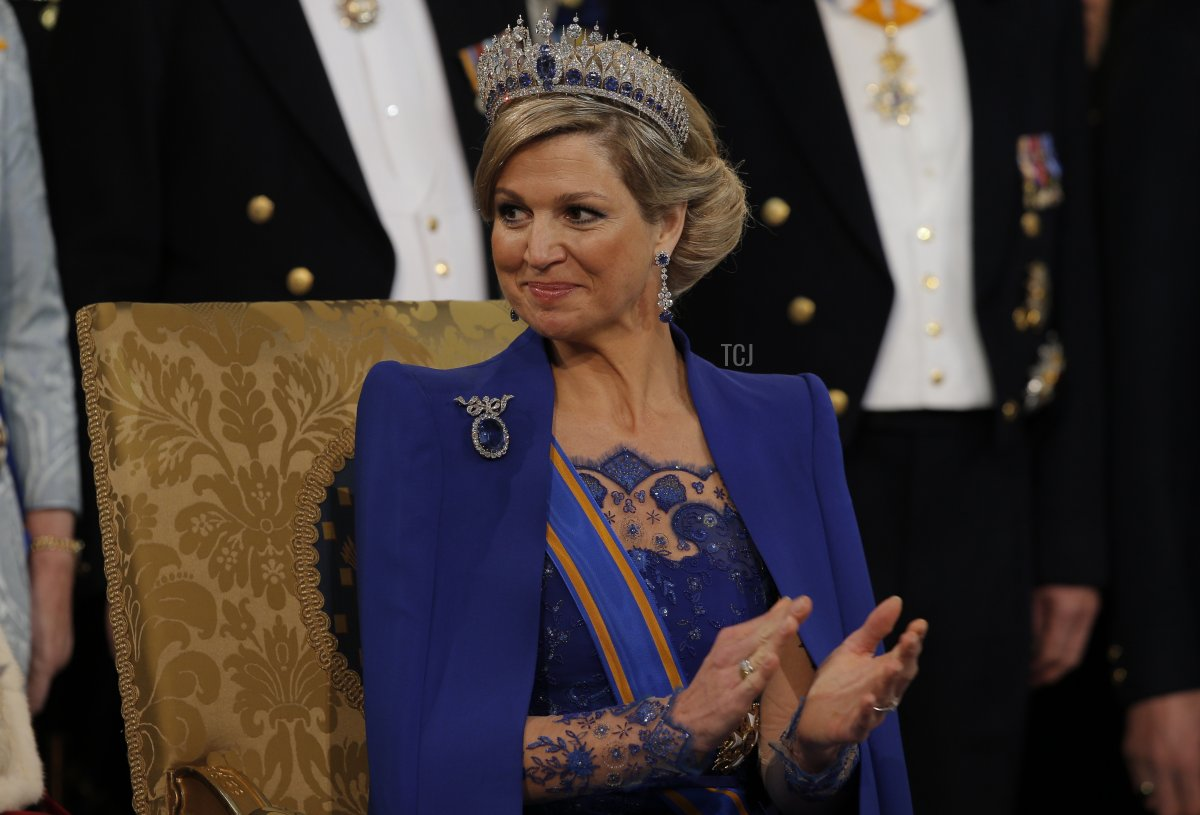 Queen Maxima of the Netherlands applauds while attending the inauguration ceremony for her husband King Willem-Alexander of the Netherlands on April 30, 2013 at Nieuwe Kerk (New Church) in Amsterdam