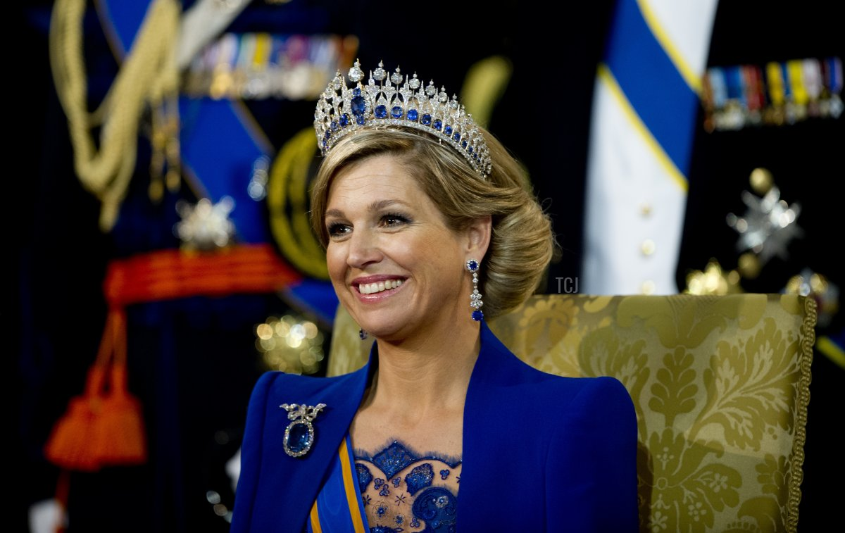 Queen Maxima smiles after the inauguration of her husband King Willem-Alexander of the Netherlands at the Nieuwe Kerk (New Church) in Amsterdam, on April 30, 2013