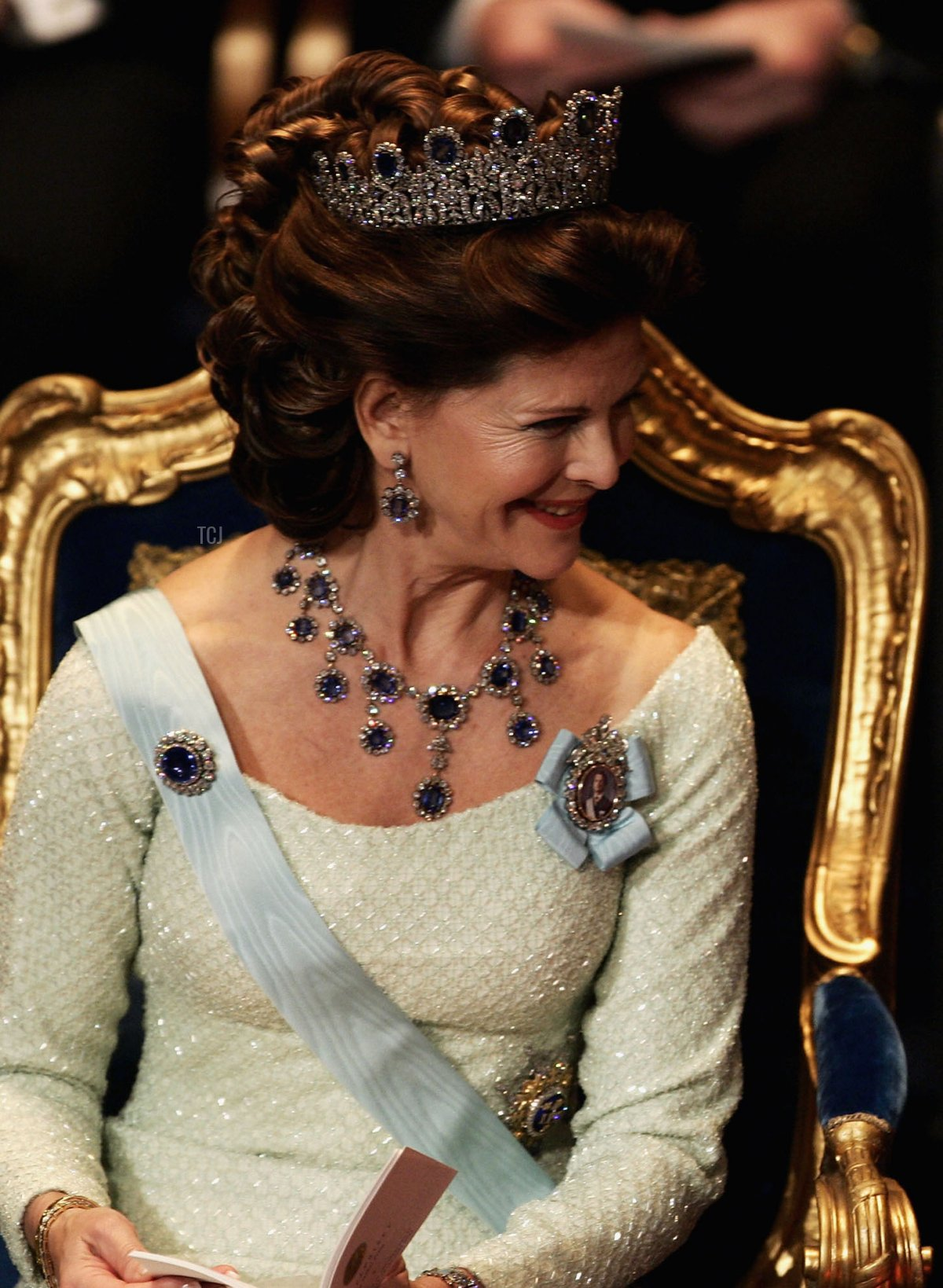 Queen Silvia of Sweden talks to Princess Lilian during the awarding ceremony of the Nobel Prizes at City Hall December 10, 2004 in Stockholm, Sweden