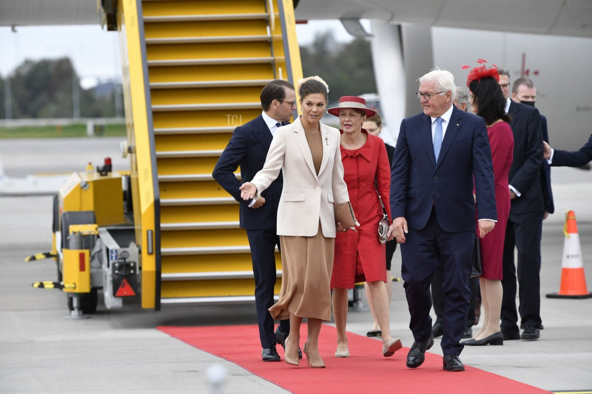 German President Frank-Walter Steinmeier (R) and his wife wife Elke Buedenbender (2nd R) are received by Sweden's Crown Princess Victoria (2nd L) and Prince Daniel (L) at Arlanda airport outside Stockholm, on September 7, 2021
