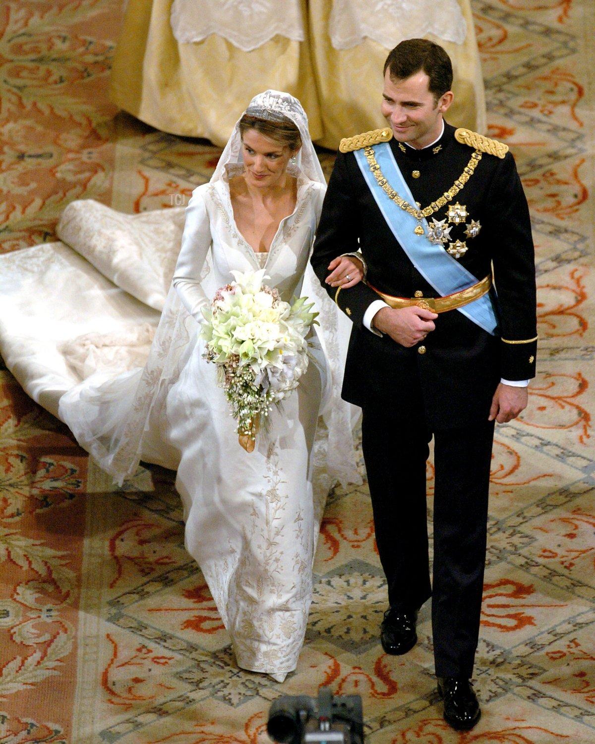 Spain's Crown Prince Felipe de Bourbon walks next to his bride Letizia Ortiz during their wedding ceremony in Almudena cathedral May 22, 2004 in Madrid