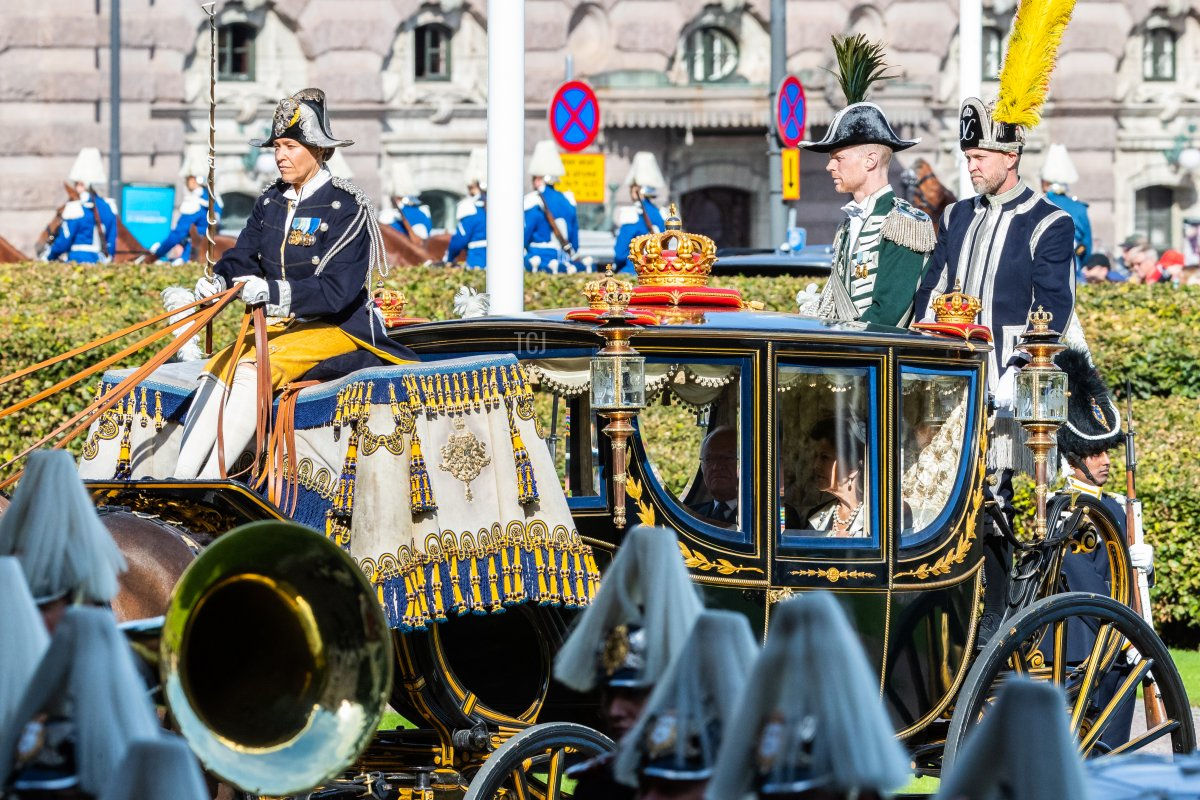 King Carl XVI Gustaf of Sweden and Queen Silvia of Sweden arrive bya horse and carriage at ceremony in connection with the opening of the Swedish Parliament for the 2021/22 work year at the Swedish Parliament House on September 14, 2021 in Stockholm, Sweden