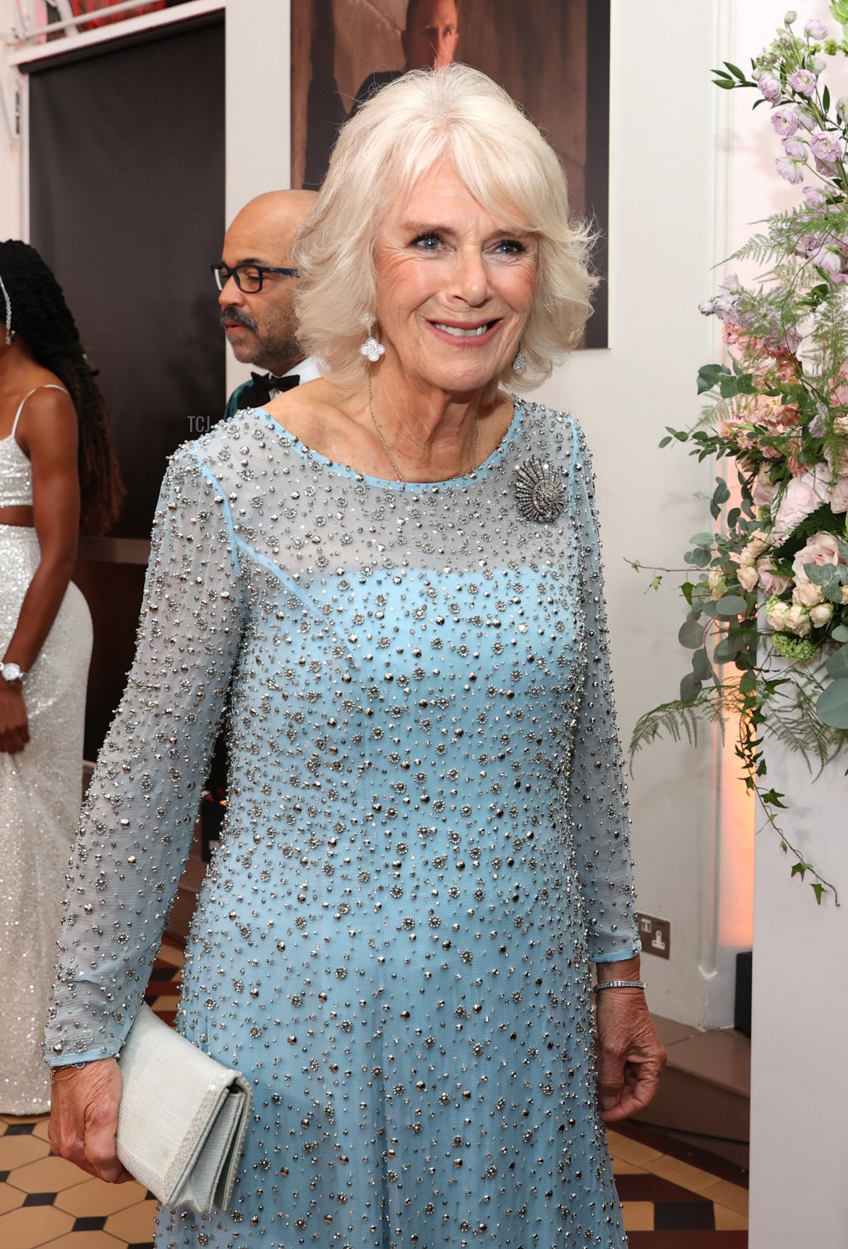 """Camilla, Duchess of Cornwall, meets some of the cast including Ben Whishaw at the """"No Time To Die"""" World Premiere at Royal Albert Hall on September 28, 2021 in London, England"""