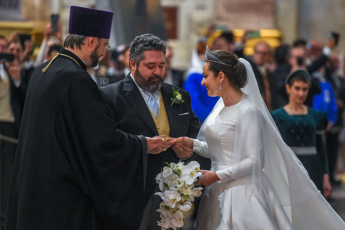 Grand Duke George Mikhailovich Romanov and Victoria Romanovna Bettarini exchange rings during their wedding ceremony at Saint Isaac's Cathedral in Saint Petersburg, on October 1, 2021