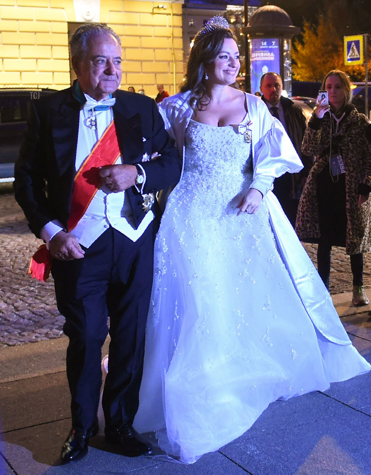 Victoria Romanovna Bettarini accompanied by her father, Roberto Bettarini, arrives to attend a dinner after her wedding with Grand Duke George Mikhailovich Romanov in Saint Petersburg, on October 1, 2021