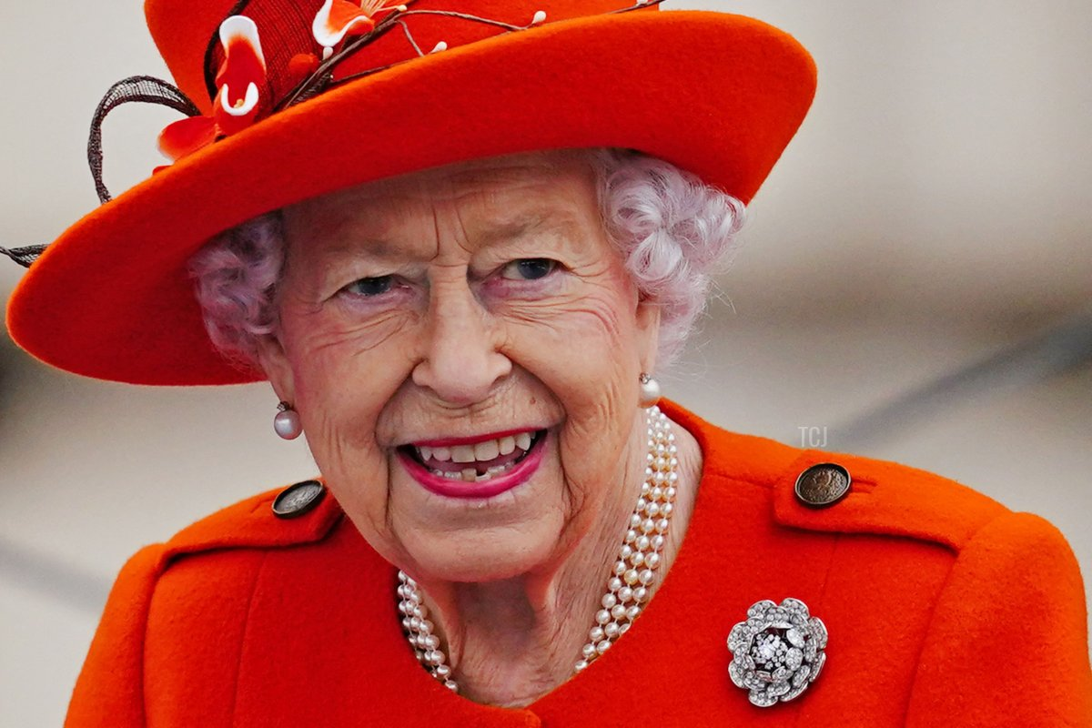 Britain's Queen Elizabeth II takes part in the launch of the Queen's Baton Relay for the Birmingham 2022 Commonwealth Games, from the forecourt of Buckingham Palace in London on October 7, 2021