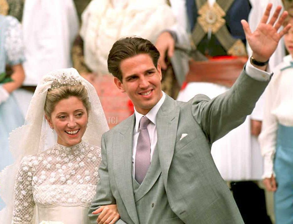 Prince Pavlos, (R), heir to the Greek throne in exile, and his bride Marie-Chantal Miller, daughter of American-born businessman Robert W. Miller, wave after their wedding ceremony at the Greek Orthodox St Sophia's Cathedral in London 01 July 1995