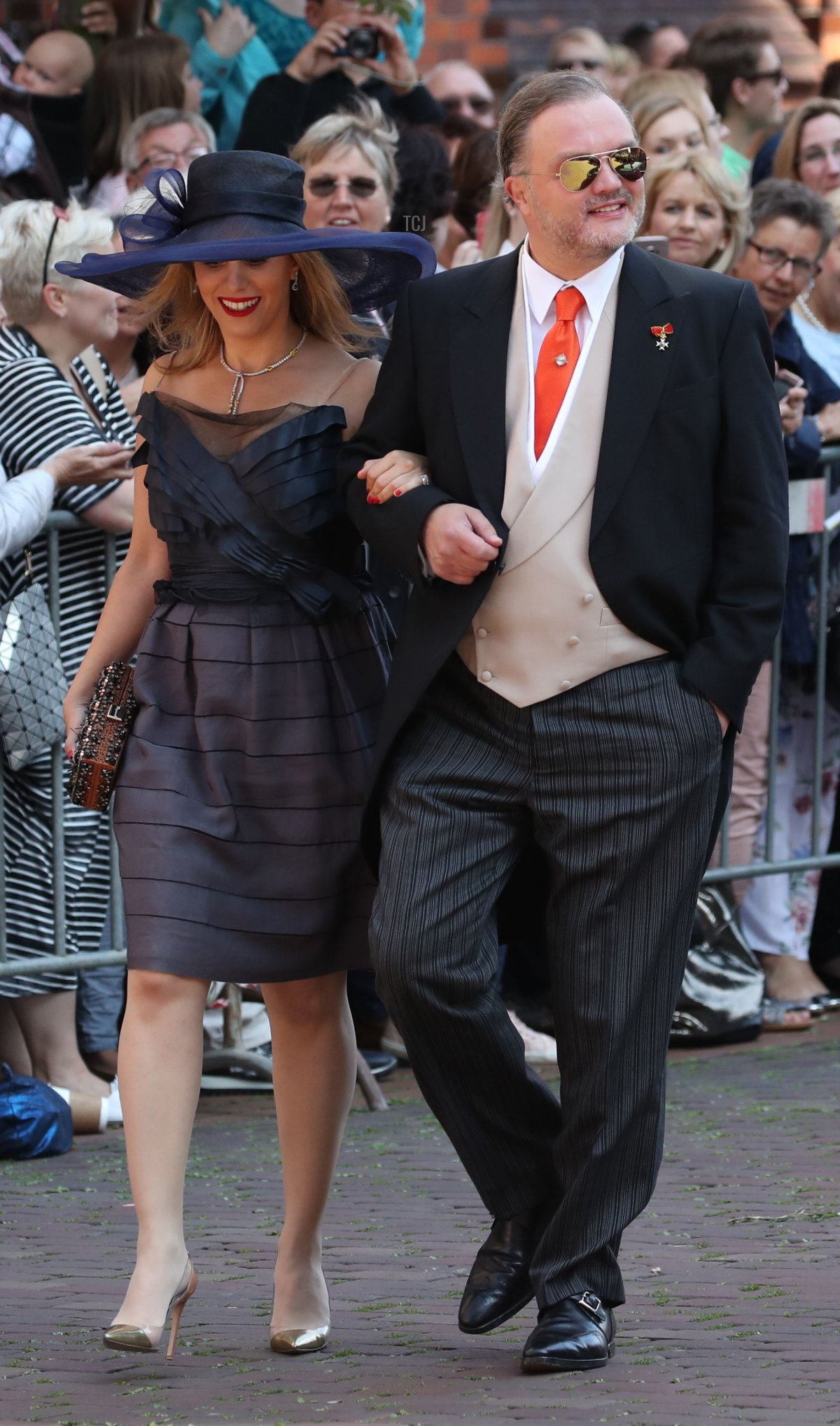 Alexander zu Schaumburg-Lippe (R) and his partner Mahkameh Navabi arrive for the church wedding of Prince Ernst August of Hanover and Ekaterina of Hanover in Hanover, central Germany, on July 8, 2017