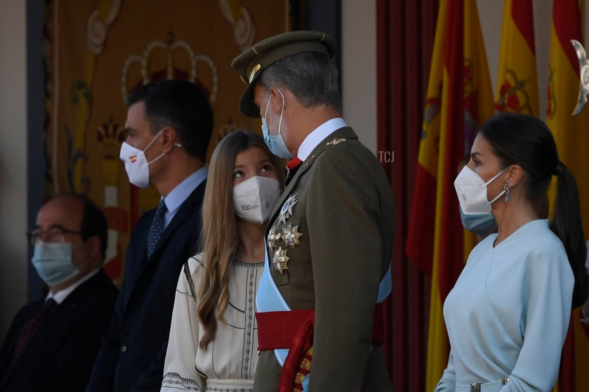 Queen Letizia of Spain (R), King Felipe VI of Spain (2ndR), Spanish Princess Sofia (C) and Spain's Prime Minister Pedro Sanchez, attend the Spanish National Day military parade in Madrid on October 12, 2021