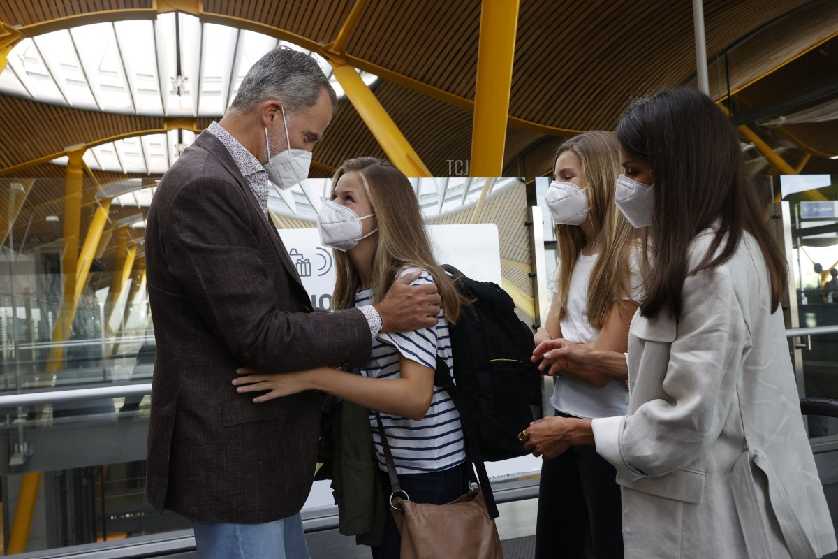 In this handout image provided by the Royal Household, Crown Princess Leonor of Spain says goodbye to her parents King Felipe VI of Spain, Queen Letizia of Spain and sister Princess Sofia of Spain at the Madrid airport before traveling to Wales to start her school year at UWC Atlantic College on August 30, 2021 in Madrid, Spain