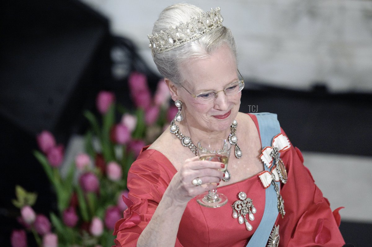 Danish Queen Margrethe raises her glass at Christiansborg Palace in central Copenhagen on April 13, 2010 during the official dinner party in celebration of the queens 70 years birthday