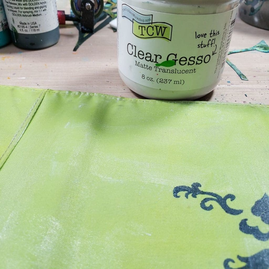 Add clear gesso to the planner cover so the paint doesn't bleed through it.