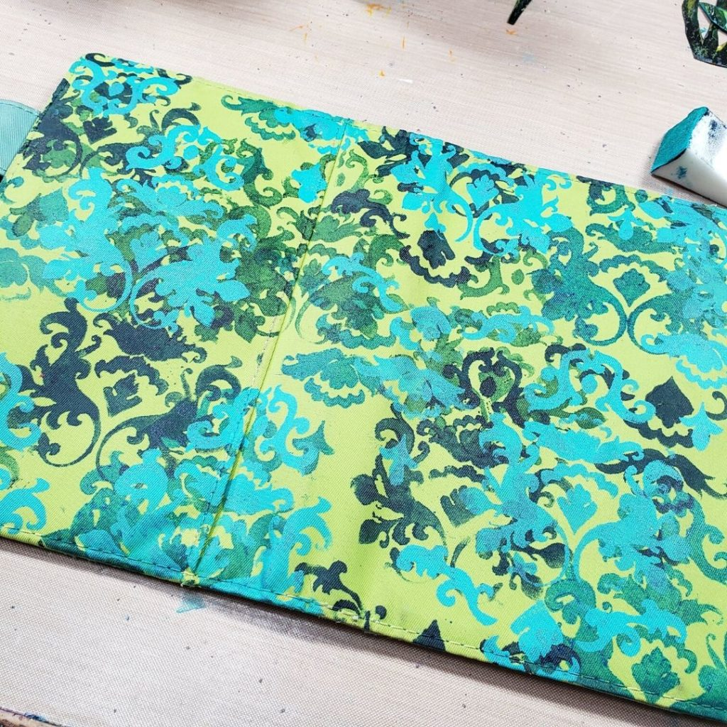 Added TCW242 Damask stencil to the cover in shades of blue and green acrylic paints.