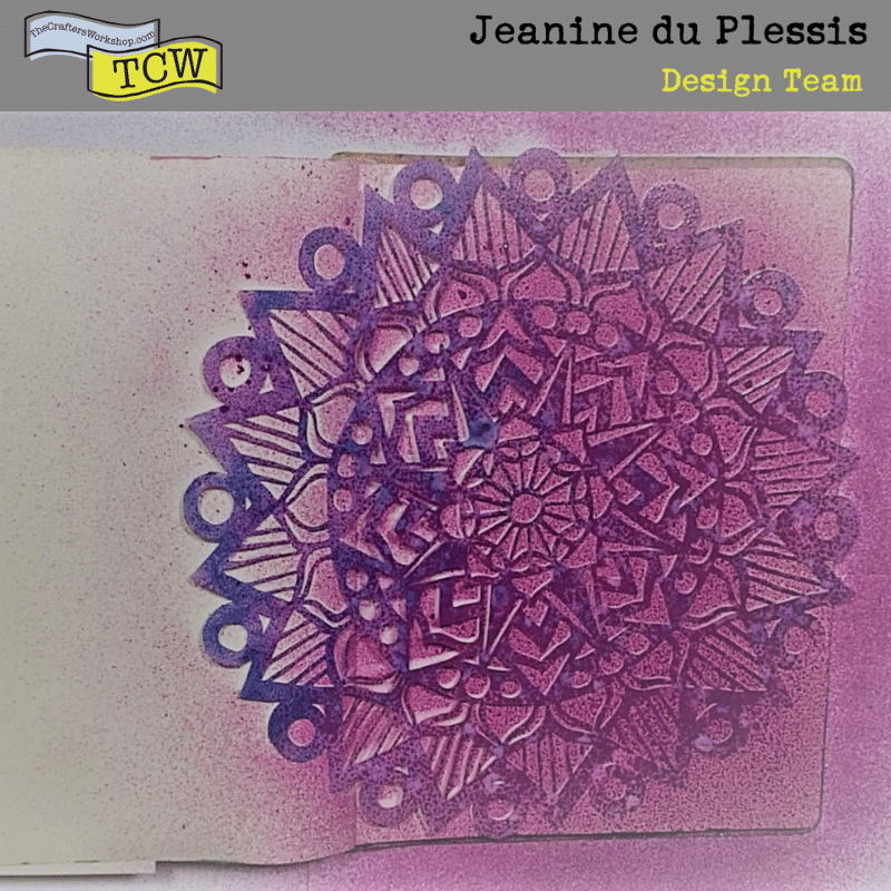 Picture of Art journal with eggplant color sprayed through Stencil TCW899 - Striped Mandala.