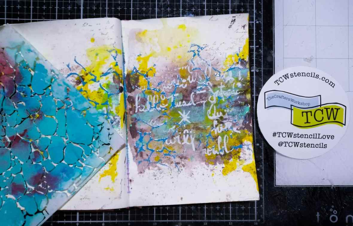 Mixed media journal background with heat embossing and stenciling