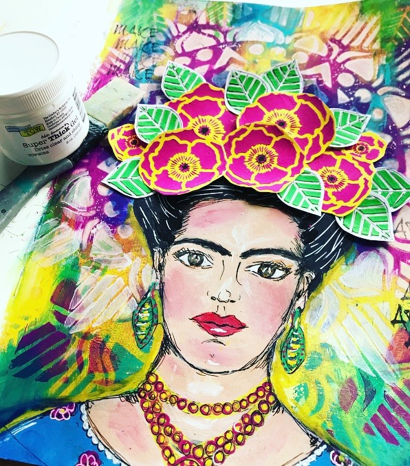 Art Journal image of Frida Kahlo with gorgeous flowers in her hair created with The Crafters Workshop Stencil and a rainbow Mandala background.  #tcwstencillove