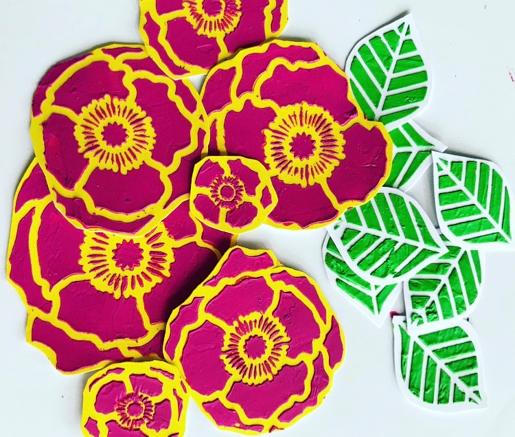 pink and yellow poppies cut out in a pile with green leaves #tcwstencillove