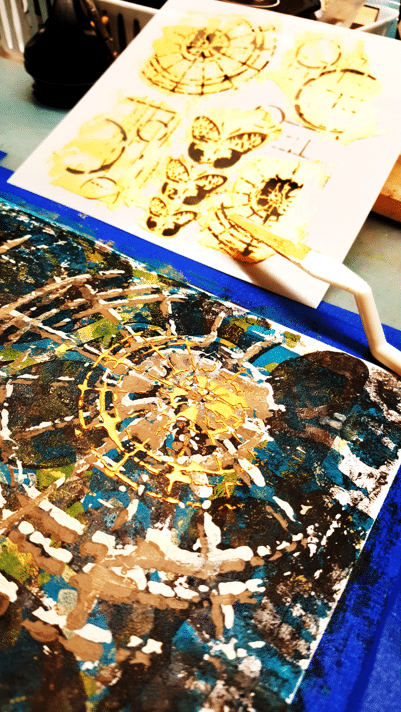 Layer 8  - Champagne Gold modeling paste applied through the stencil using a palette knife.