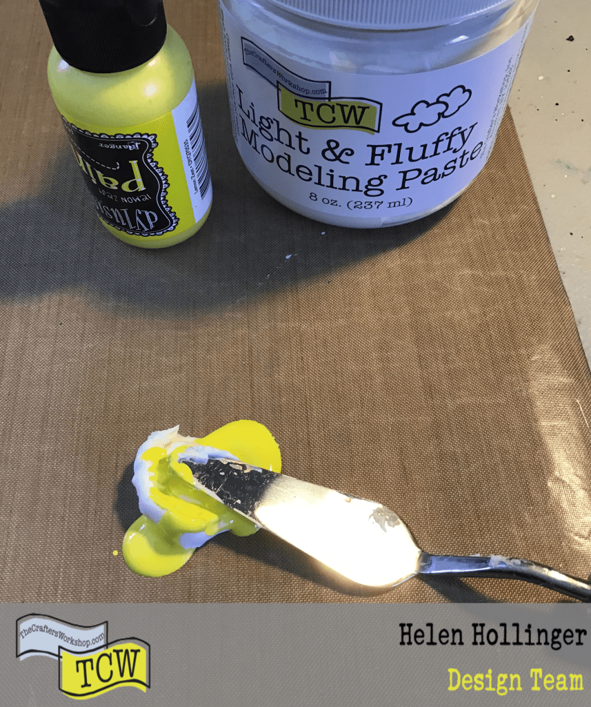 Mixing Lemon Zest paint in the Light and Fluffy Modeling Paste to make the paste yellow.