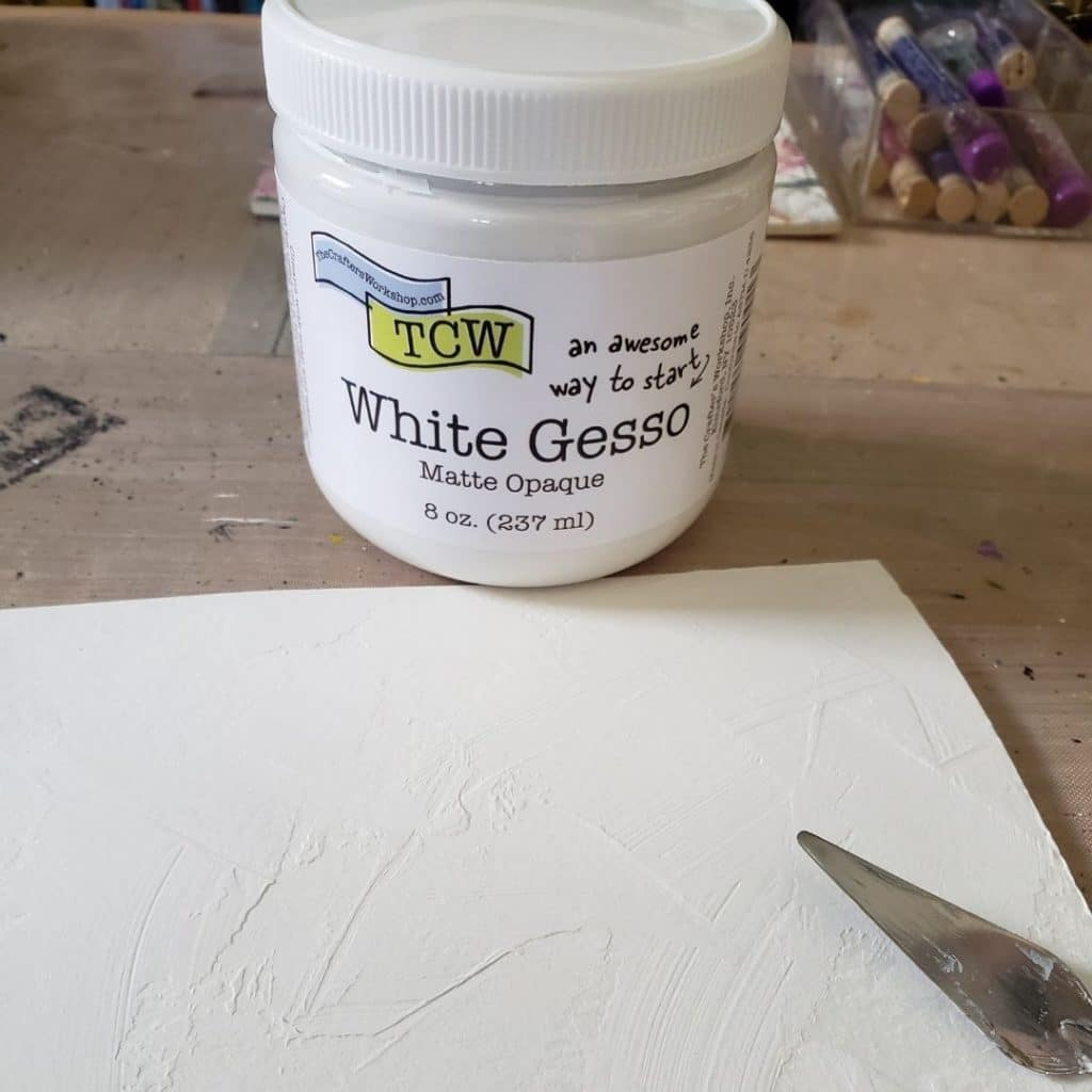 Adding gesso to the background with a palette knife