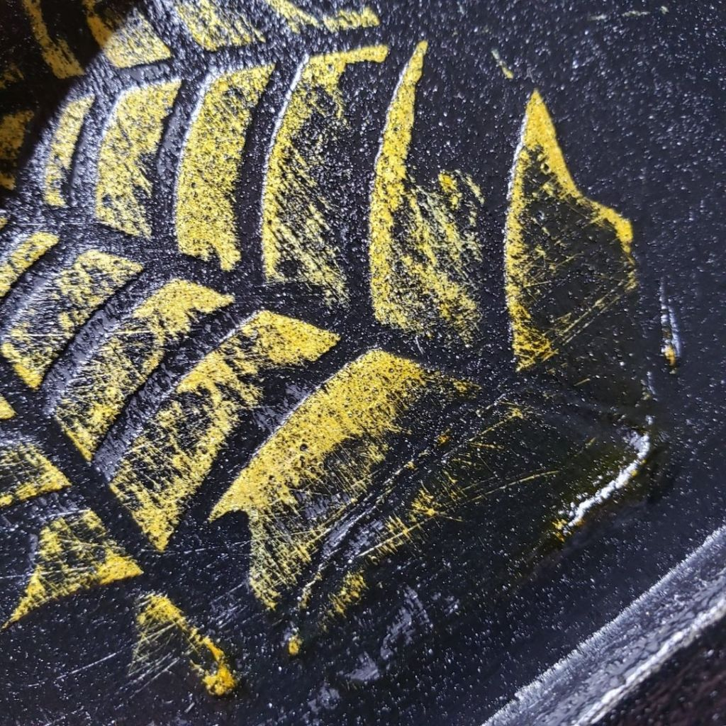 When the black paint dried I used sandpaper to remove some of the black paint.