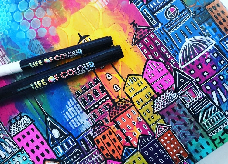 adding in details of cityscape using paint pens