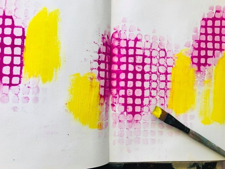 adding yellow paint to the background
