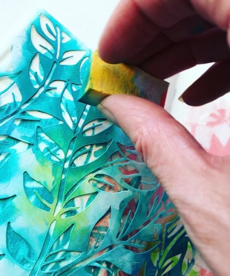 sponging through leaf stencil with a makeup sponge