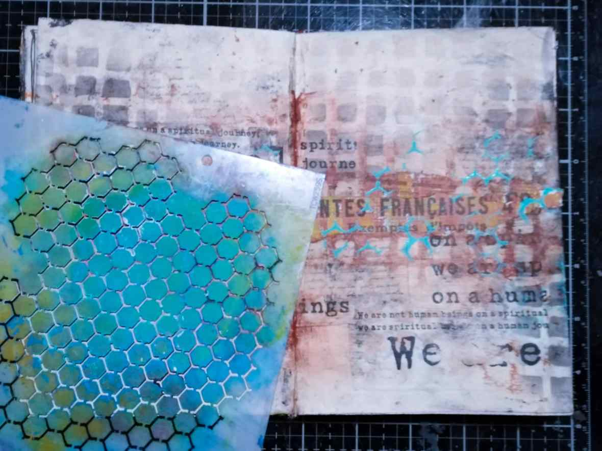Stenciling with acrylic paints, mixed media art journal