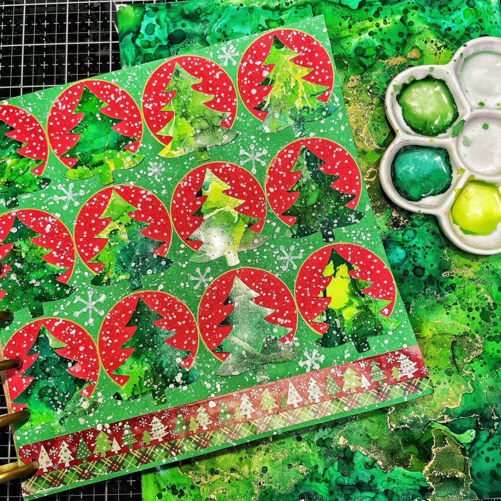 Alcohol ink Christmas trees on an art journal page
