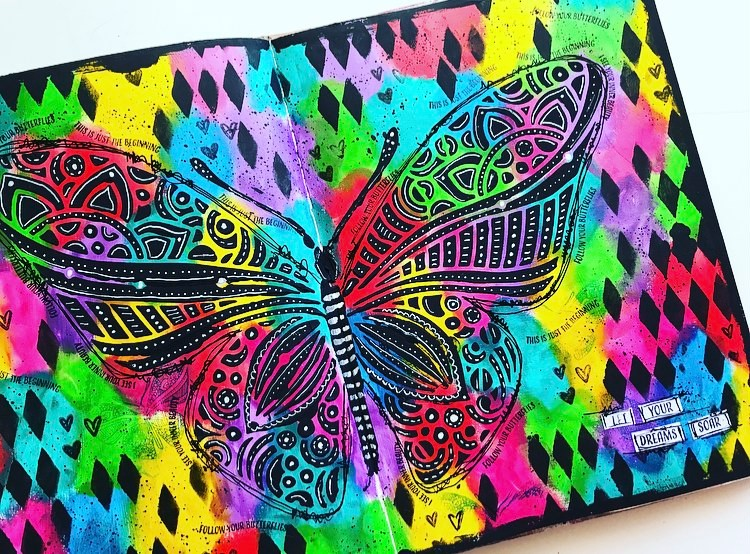 completed art journal page. lots of rainbow sheen in background and a large black butterfly stenciled on top #tcwstencillove Tammy Klingner