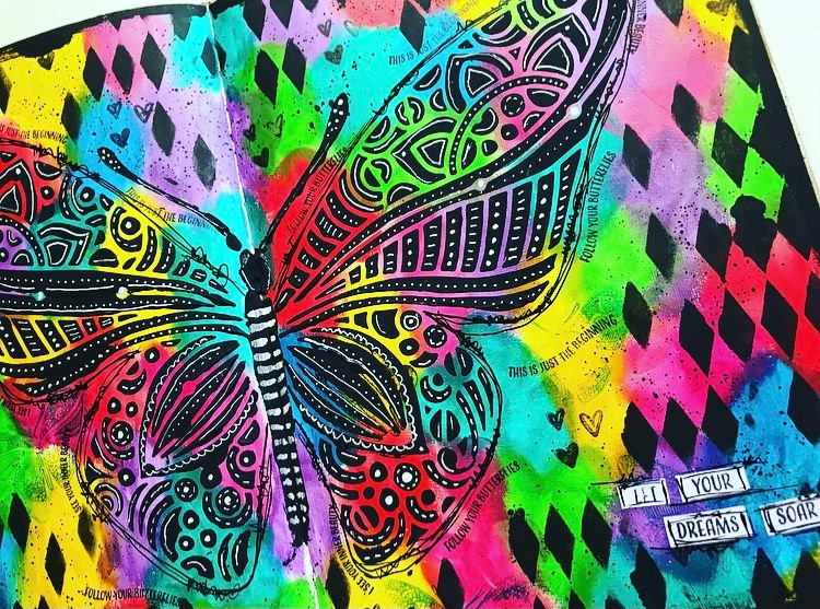 close up of butterfly created with black modeling paste and white doodling added