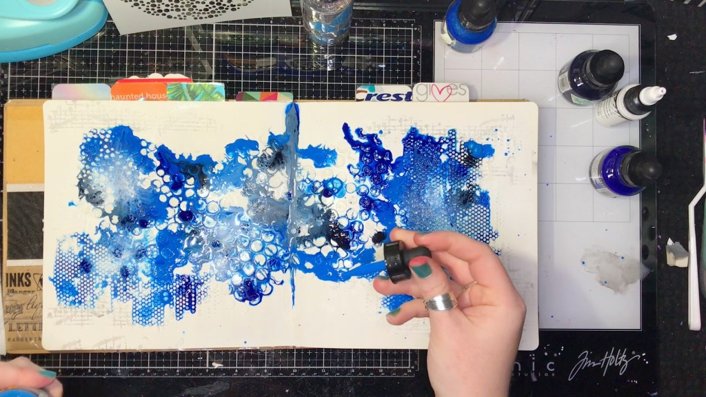 Blue and White fluid acrylic ink blended over textured layout